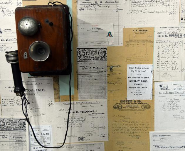 A historic telephone and bills and receipts from days gone by.