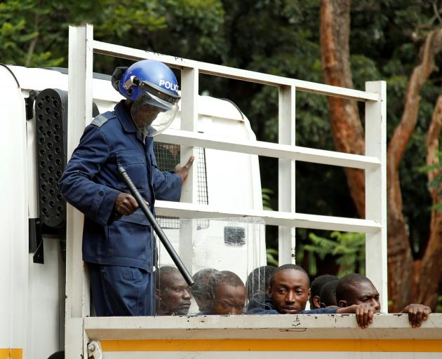 People arrested during protests wait to appear in the Magistrates Court in Harare. Photo: Reuters