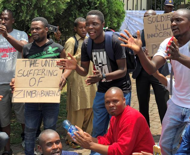 Zimbabweans demonstrate outside the Zimbabwe embassy in Pretoria. Photo: Reuters