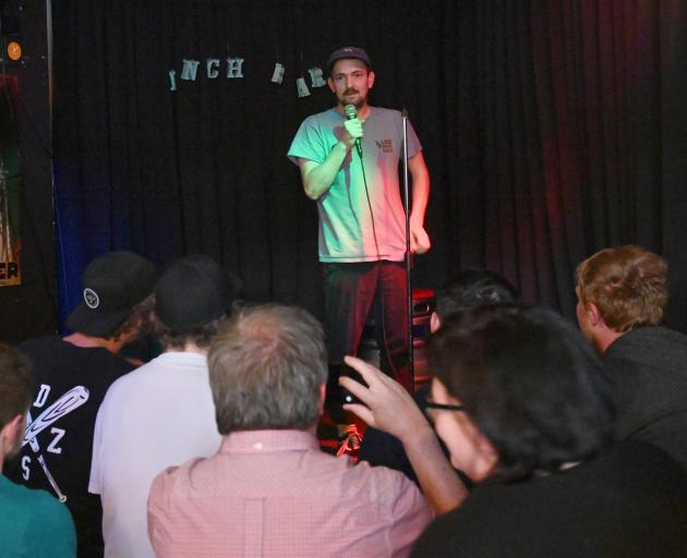 In a bid to overcome a fear of public speaking Tim Miller tries his hand at stand-up comedy at an open mic night alongside more experienced comedians. Photos: Linda Robertson