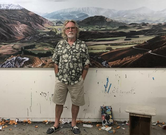 Artist Dick Frizzell is flanked by Wakatipu Basin, one of his paintings that will appear in an...