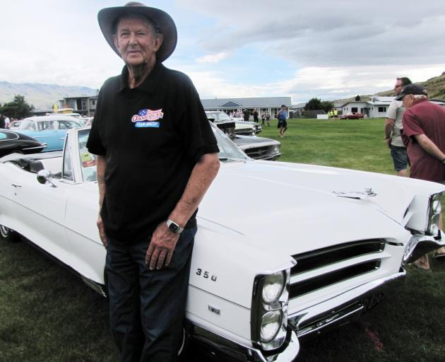 Norman Fisher, of Twizel, shows off his 1966 Pontiac Parisienne convertible  at the Cromwell...