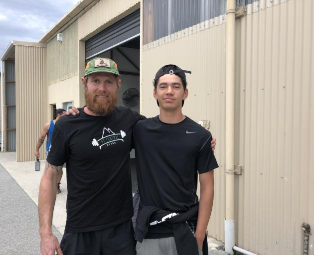 Preparing for a military-style workout session are retired US Navy Seal Chadd Wright (left) and...