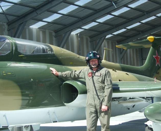 Aviation enthusiast Peter Meadows, of Alexandra, is making himself right at home in his prized L-29 Delfin fighter jet. Photo: Adam Burns