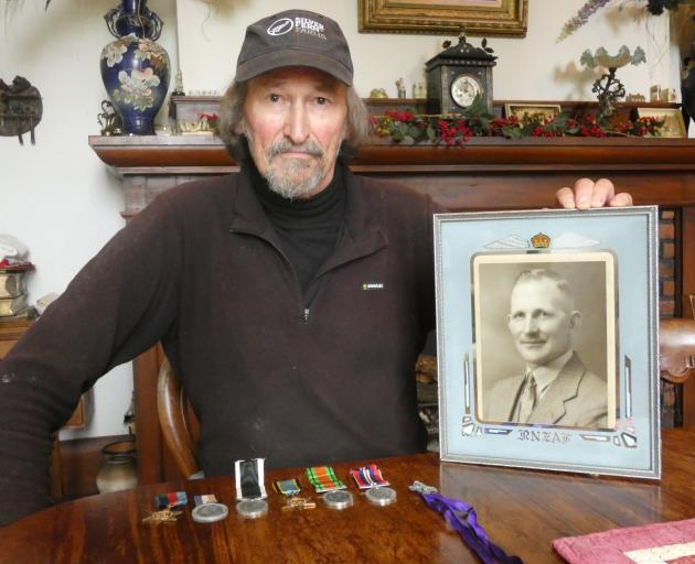 Alex Holms, nephew of Flight Sergeant Alexander Hunter Holms, with his uncle's photo and medals....
