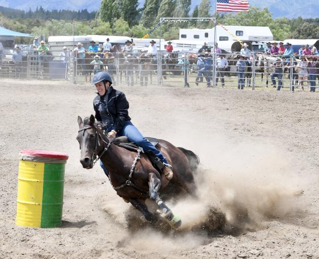 Alyce Perkins from Gore competes in the open barrel race at the Wanaka rodeo. Photo: Stephen Jaquiery