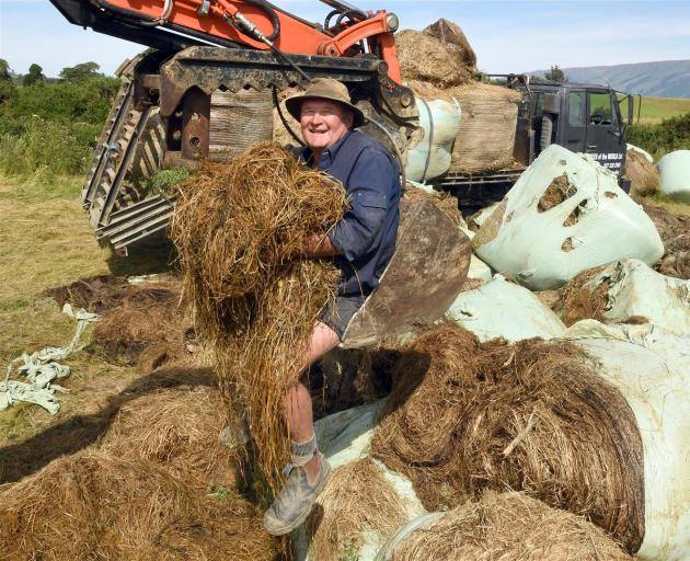 Nursery owner Rodney Hogg has been collecting baleage swept up in November's flood from the road and from farmers' paddocks. Photo: Stephen Jaquiery