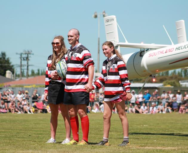 Blair Vining arrives at the Blair Vining Bucket List Rugby Game by helicopter with his daughters...