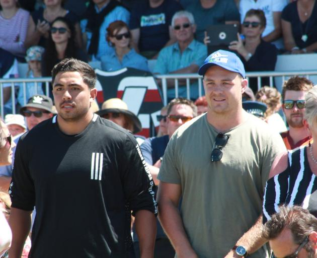 All Blacks Anton Lienert-Brown (left) and Sam Cane watch the Blair Vining Bucket List match from the sidelines. Photo: Ben Waterworth