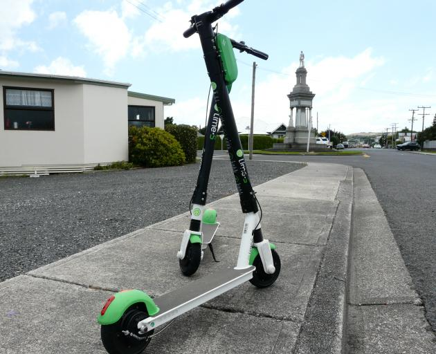 Lime scooters at rest on Renfrew St, Balclutha, near the town's cenotaph, yesterday afternoon....