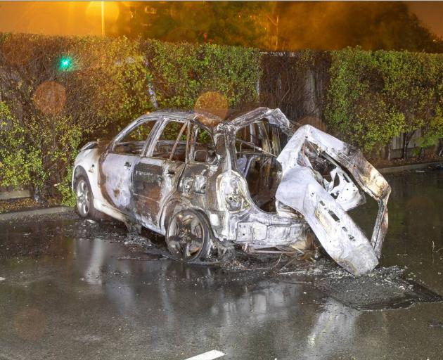 The burnt-out wreckage of a car that chrashed on Blenheim Road. Photo: Supplied