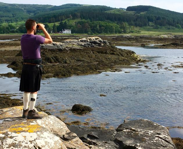 Never without his kilt, Tommy, our guide, otter spotting on Mull.