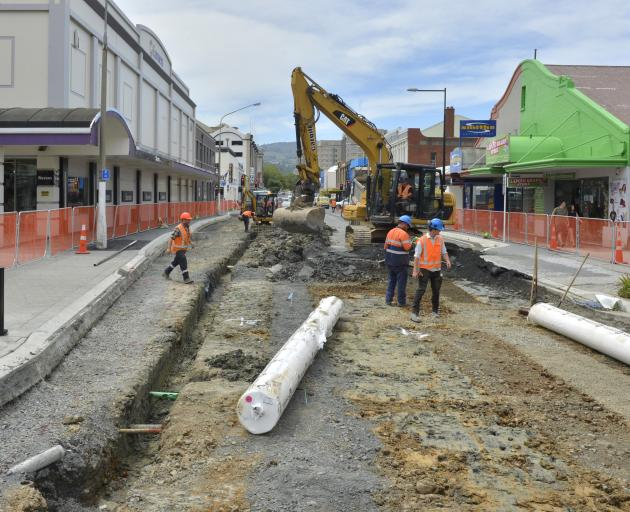 The latest work on Dunedin's new bus hub involves deep excavations on Great King St to flatten the road, as well as the removal of temporary drainage channels installed only weeks ago. Photo: Christine O'Connor