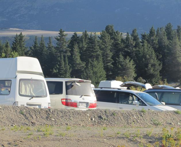 A line-up of camper vans at the Red Bridge ``hub'' near Luggate. PHOTO: MARK PRICE