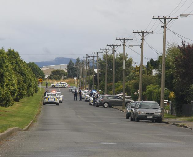 Police stand guard outside a house in Drury Lane in Invercargill's Grasmere suburb where there...