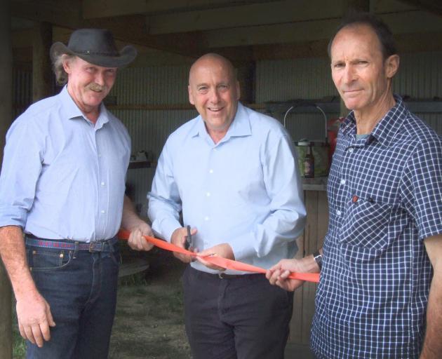 Central Otago Mayor Tim Cadogan is flanked by Omakau-Earnscleugh Collie Club life members Bill...