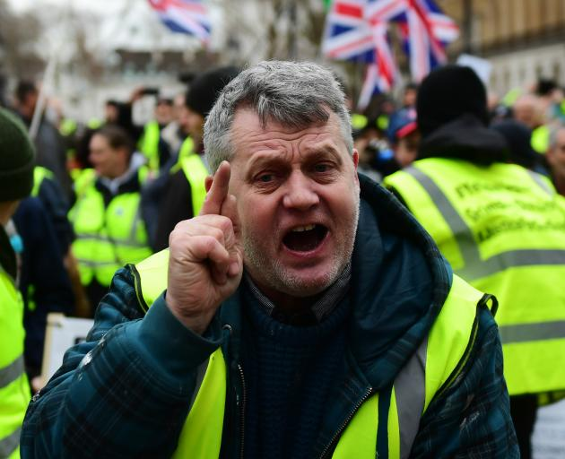 Pro-Brexit demonstrators wearing yellow vests protest in Westminster, London, earlier this month....