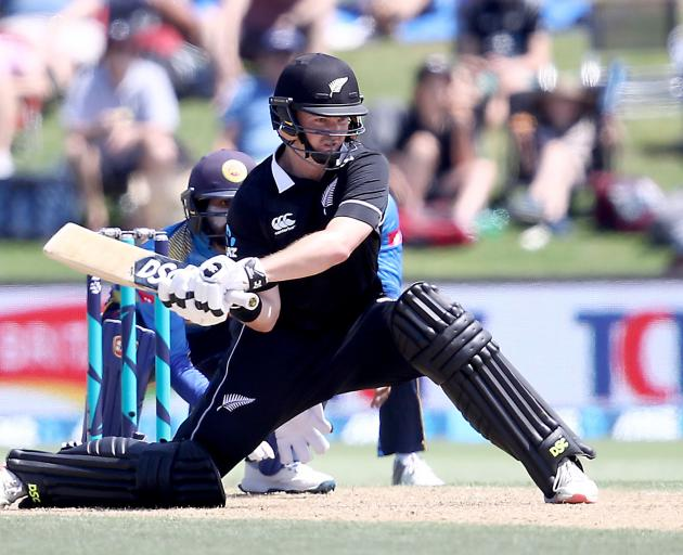 Colin Munro improvises with a reverse sweep on his way to 87. Photo: Getty Images