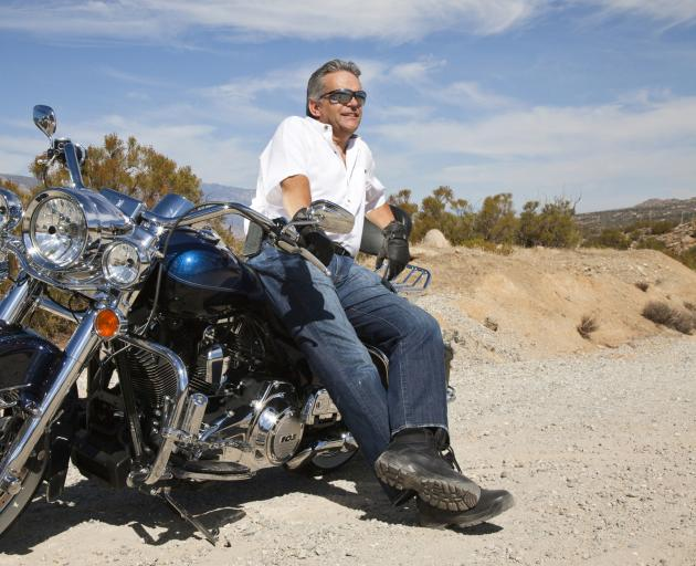 Motorcycles and soft-top convertibles are among the archetypal responses to a male mid-life crisis. Photo: Getty Images