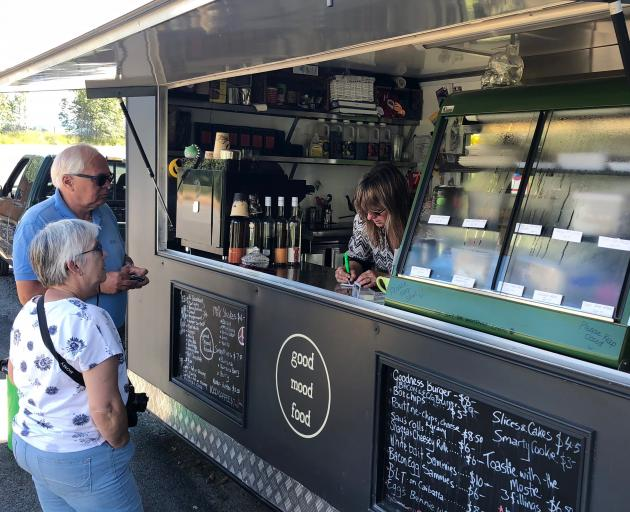 Western Southland tourism operator Joyce Kolk serving customers at the riverside food cart. Photos: Supplied