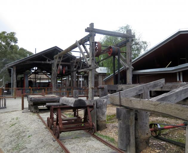 A historic demonstration of saw milling at Echuca Wharf.