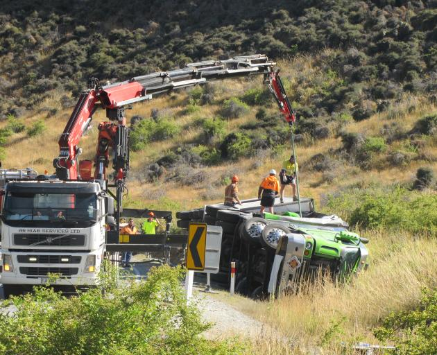 Workers prepare to recover a Summerlands freight truck carrying dangerous goods that crashed in the Lindis Pass yesterday. Photo: Mark Price