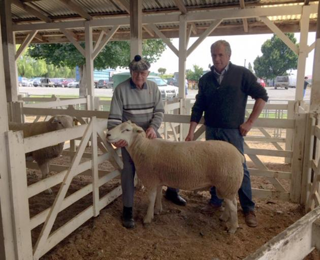Vendor Peter Black (left) and buyer Garth Shaw, of Wharetoa Genetics, with the top-priced Texel...