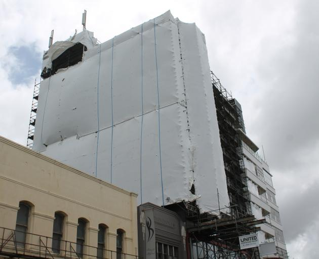 A new 33m mural remains covered at the Kelvin Hotel in Invercargill, after the unveiling was postponed due to bad weather. PHOTO: BEN WATERWORTH
