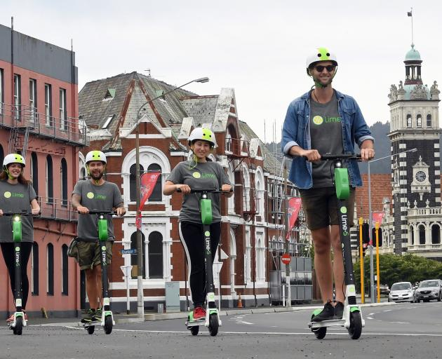 Taking the Lime e-scooters for a spin down the Cumberland St shared cycle path before the launch of the service in Dunedin today are Lime city launcher (front right) Matt McNeill and employees Elena Khoo, James Samme and Ellie Fanning. Photo: Stephen Jaqu