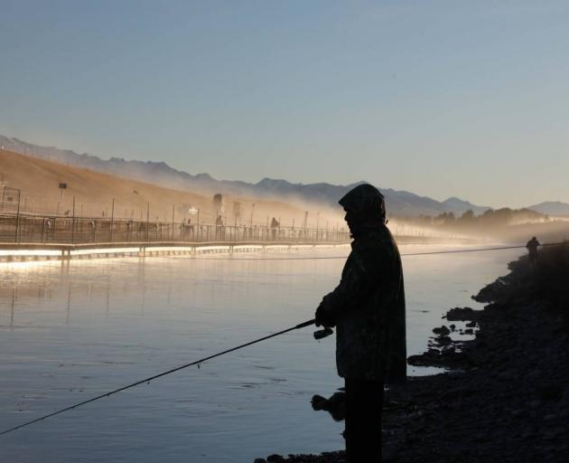 A fisherman on a canal in the Mackenzie Basin. Photo: Richard Cosgrove, Fish and Game NZ.