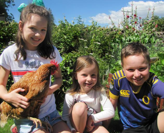 Love family members (from left) Annie (10), Lily (5) and Reuben (12) reflect on the adventures of...