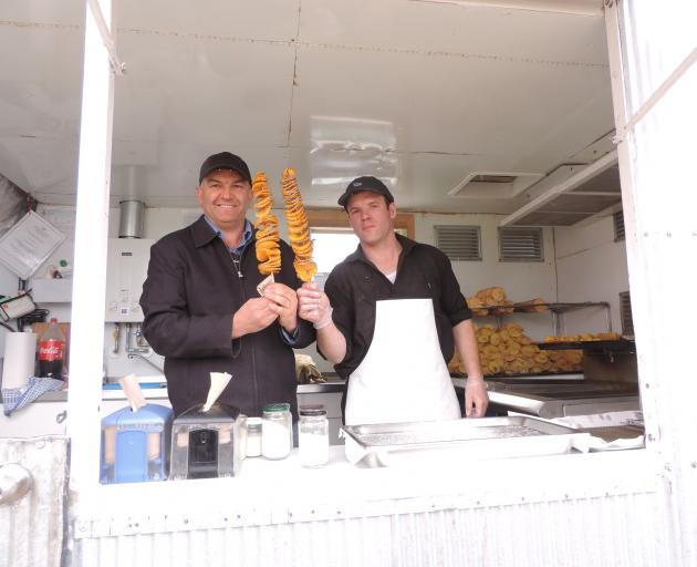 Palmerston and Waihemo A&P Association president Garry Dodd (left), shown cooking his Curly Fries invention with Greg McLeod, is keen to attract young people to the East Otago Show. Photo: Sally Brooker