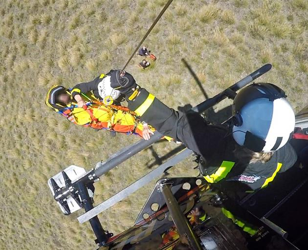 A man who had a heavy landing while paragliding at Treble Cone yesterday was flown to the Lakes District Hospital by the Otago Regional Rescue Helicopter with serious injuries. Photo: Supplied