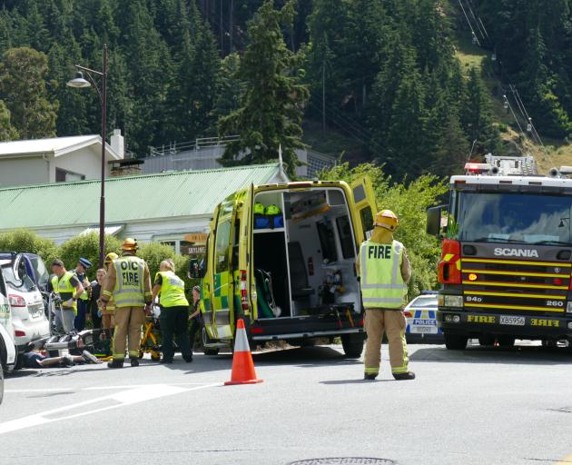 Emergency services at the scene of a serious crash between a motorbike and car in Man St, Queenstown. Photo: Daisy Hudson