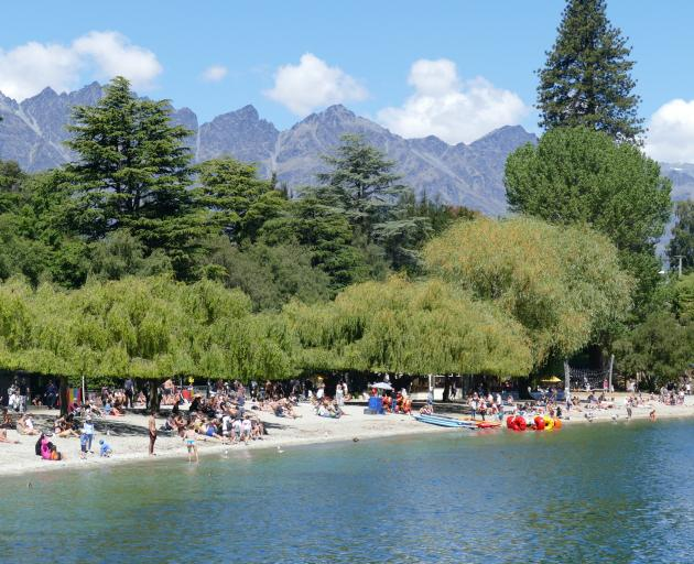 Hundreds of people make the most of balmy temperatures in Queenstown Bay last month. Photo:...