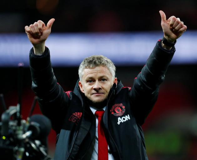 Manchester United interim manager Ole Gunnar Solskjaer celebrates after his team's win against...