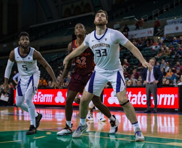 Sam Timmins boxes out his man as Washington plays Virginia Tech earlier this season. Photo: Getty...