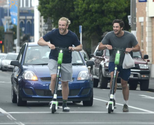 Among many enjoying a spin on Lime scooters in Dunedin yesterday morning are Highlanders locks...