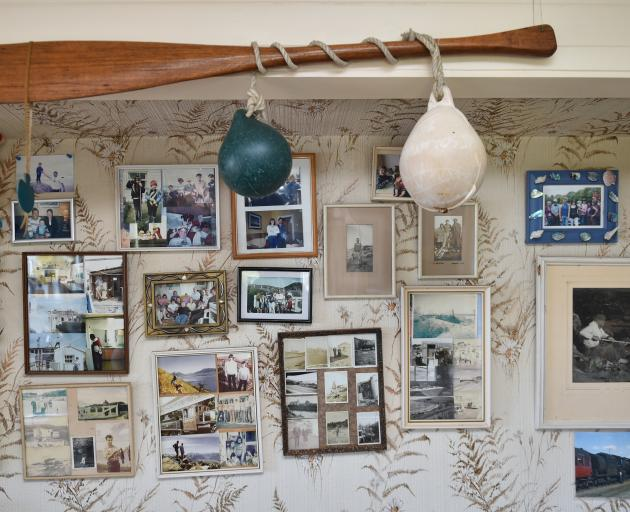 The crib's interior is filled with an assortment of family photos and old knick-knacks carefully...