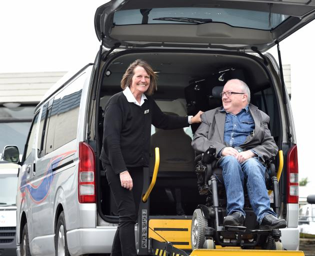 Southern City Taxis driver Julie Manson helps Chris Ford in to one of the company's total...