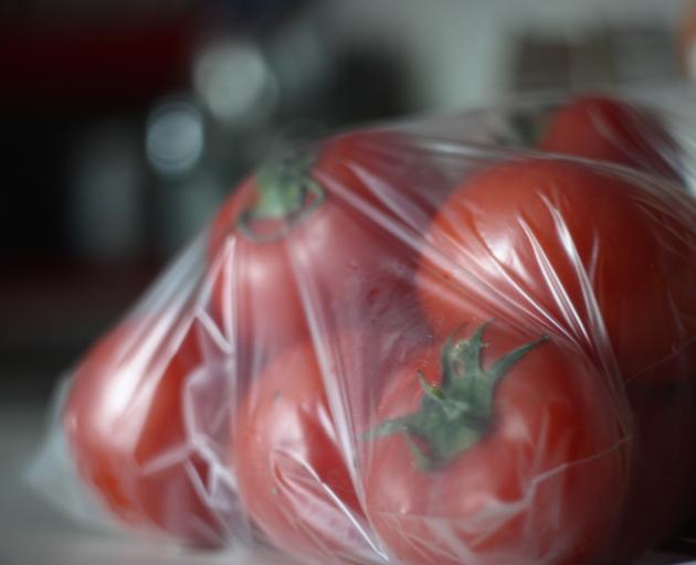 Close-Up Of Tomatoes In Plastic Bag. Photo: Getty Images