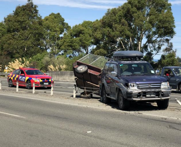 A truck collided with a 4WD before rolling off the Southern Motorway this afternoon. Photo: Supplied