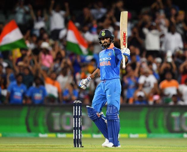 Virat Kohli celebrates his century during India's win last night. Photo: Getty Images