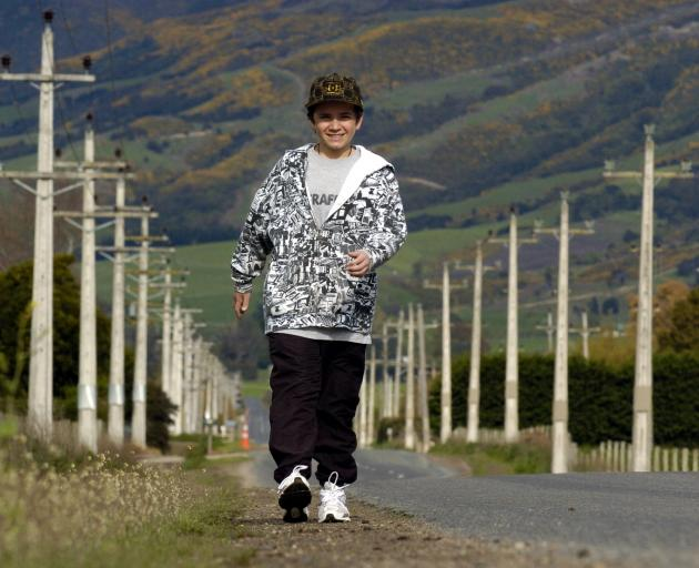 Harrison Kemp strides down Maungatua Rd, near Outram, in October 2008, in preparation for a 10km...
