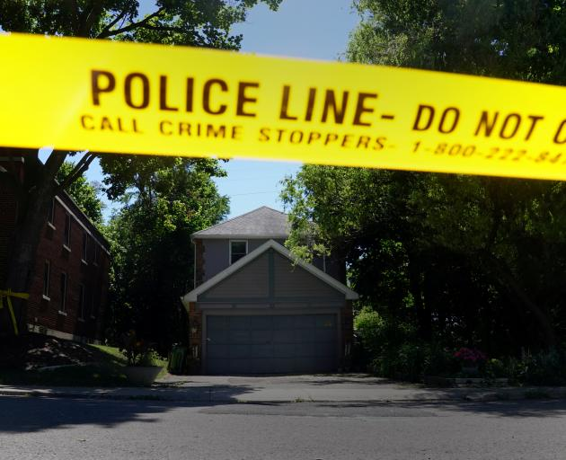 Police investigate a home that serial killer Bruce McArthur worked at in Toronto. Photo: Reuters