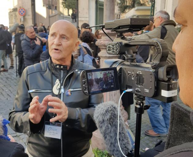 Dr Murray Heasley speaks to media while in Rome this week, during a major gathering of bishops called by Pope Francis to discuss the sexual abuse crisis engulfing the Catholic Church. Photo: Analyn Heasley