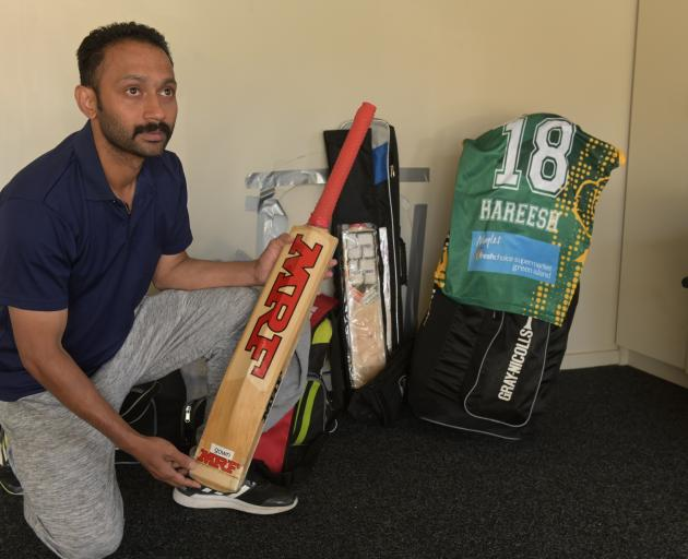 Holding the favourite bat of Hareesh Gangadharan, who died suddenly during a game for Green...