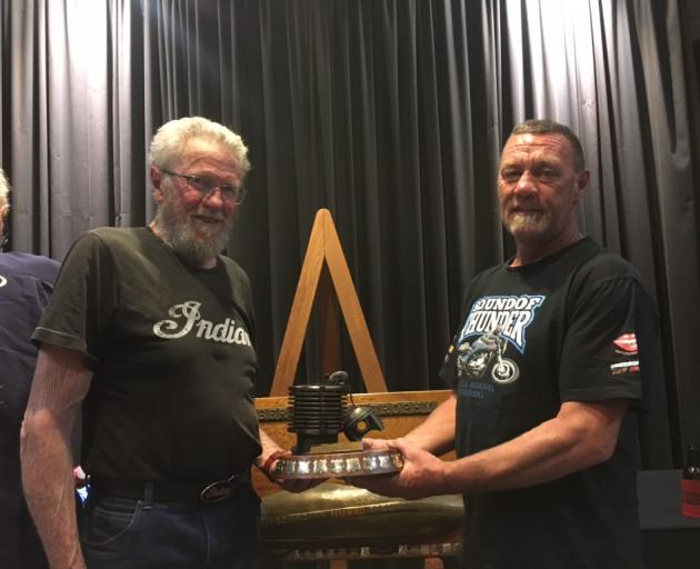 John Munro (left) presents the prestigious Spirit of Burt Munro award to Alexandra motorbike racer Butch Woods at last week's Burt Munro Challenge event. Photo: Supplied