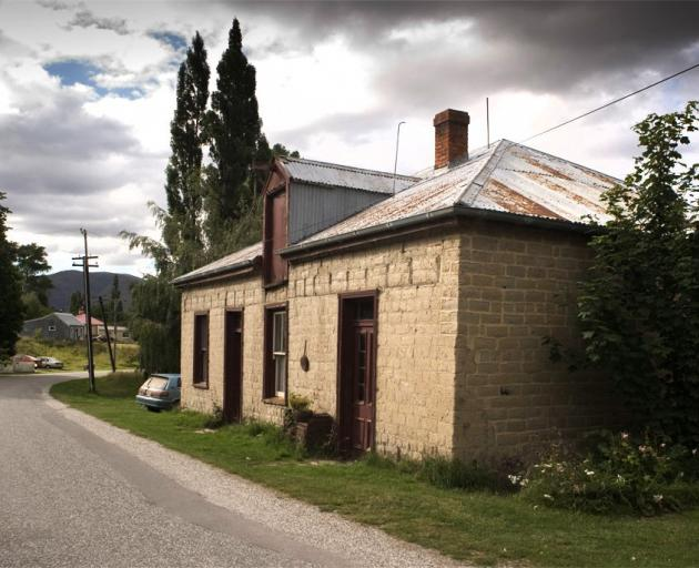 he Bellamy family's 140-year-old St Bathans mud-brick property stands under a cloudy sky. Photos: Supplied