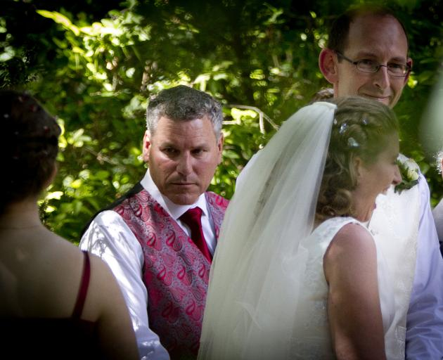 Paul Wilson (left) as groomsman to David Bain and Liz Davies during their wedding in 2014. Photo: The New Zealand Herald